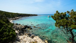 A view of a Blue Lagoon near Polis city, Akamas Peninsula National Park, Cyprus, famous blue lagoon place