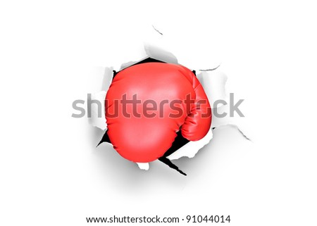A view of a boxing glove through a hole in paper