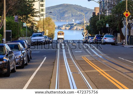 a view of a cable car cresting...