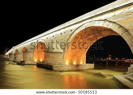 A view of a famous Stone bridge in Skopje, Macedonia, at night - stock photo