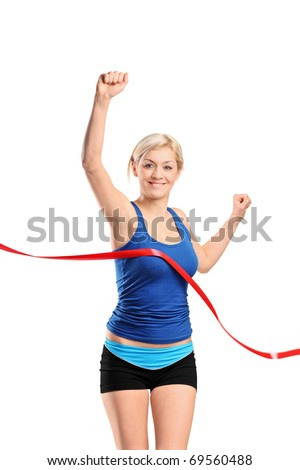 A view of a female runner running towards a finish line isolated against white background