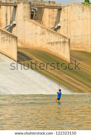 A view of a fisherman fishing on a PASAK Dam background, Thailand