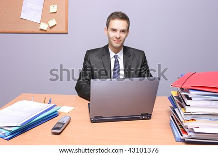A view of a happy businessman in the office
