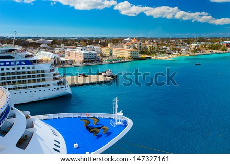 A view of a large cruise ship docked along the waterfront of Nassau, Bahamas.