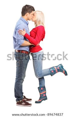 A view of a loving couple kissing isolated on white background