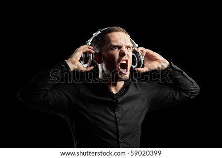 A view of a man with headphones isolated on black background