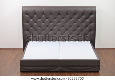 A view of a modern bed in an empty room