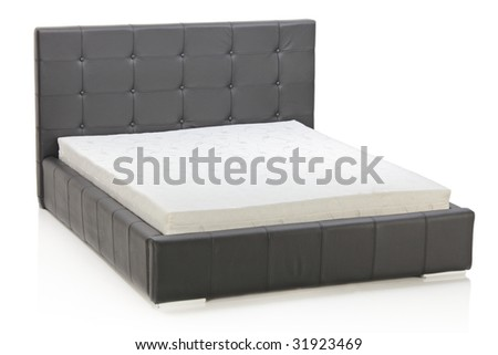 A view of a modern bed isolated on white background