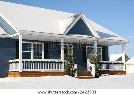 A view of a new home in winter, covered with snow.