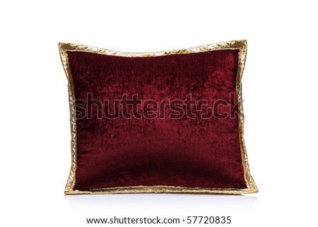 A view of a red pillow isolated on white background
