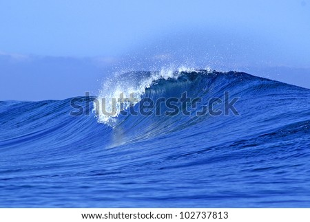 A view of a scenic blue ocean wave in Fiji