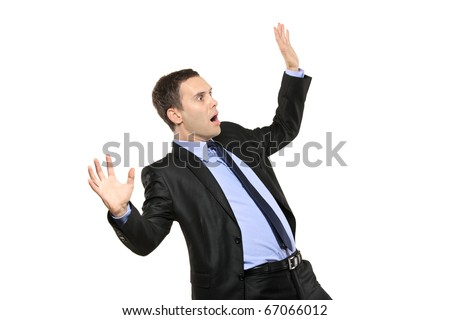 A view of a shocked young businessman isolated on white background