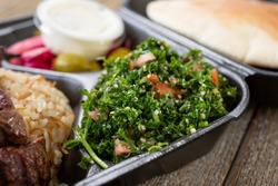 A view of a side of tabbouleh, part of a Mediterranean entree.