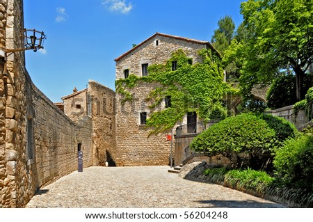 a view of a street in the old quarter of Girona, Spain