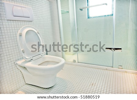 A view of a toilet in a hotel room.