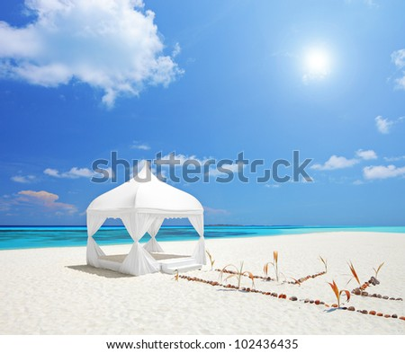 A view of a wedding tent on a beach in Maldives island