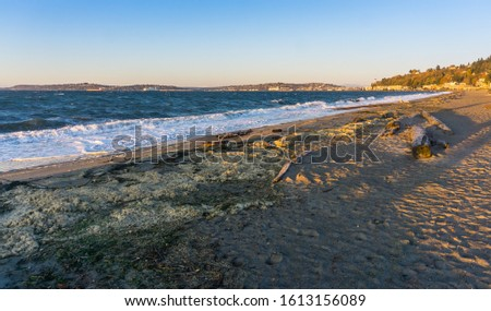 A view of Alki Beach in West Seattle, Washington on a windy day.