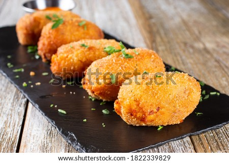A view of an appetizer plate of croquettes.