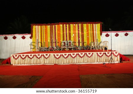 A View Of An Indian Wedding Stage With Traditional Floral