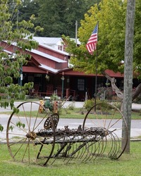 A view of an old hay rake out front of Shatley Springs, NC.