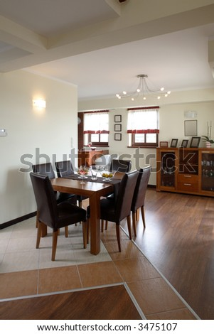 A view of an open dining room and kitchen - stock photo