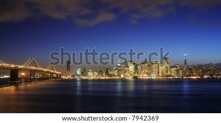 A view of Bay Bridge and San Francisco downtown decorated by Christmas lighting at dusk (shot from Treasure Island). Copyspace on top and bottom