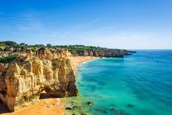 a view of beautiful sandy beach Dona Ana in Lagos, Algarve region, Portugal