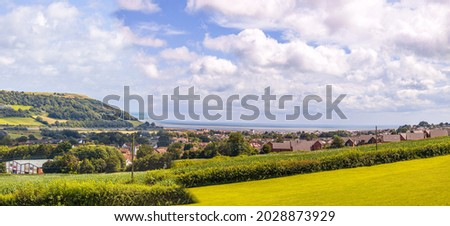 A view of beauty of the British countryside during a sunny day. The grass and fields so colorful for all to enjoy. Stok fotoğraf ©