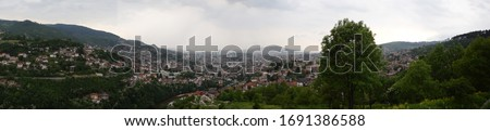 Photo of  A view of cloudy Sarajevo from the Trebević Mountain (Sniper Hills)