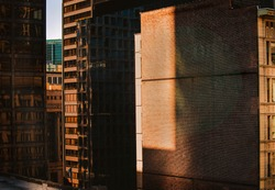 A view of downtown Chicago out of a window during golden hour.
