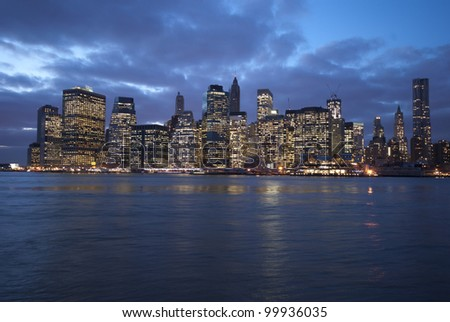 A view of downtown New York City at night from Brooklyn across the East River