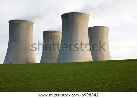 A view of four massive cement cooling towers in an open field at the nuclear power station at Dukovany, Czechoslovakia.