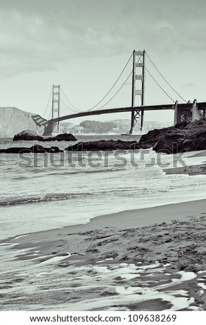 a view of Golden Gate Bridge from Baker Beach in San Francisco, United States