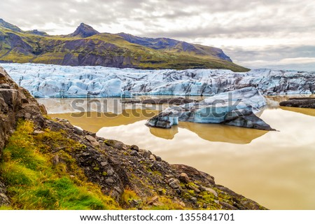 Stock Photo A view of Jokulsalron Glacier in southern Iceland and ice falling to the ocean, Iceland