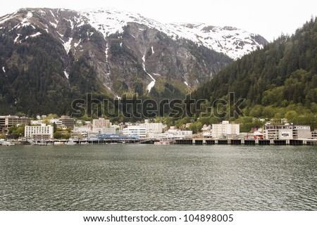 A view of Juneau, Alaska from the sea with Snow capped mountains in the background
