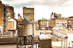 A view of old buildings and water towers in Midtown, Manhattan in New York City.