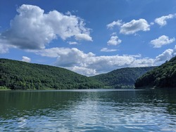 A view of Pennsylvania rolling mountains from within the Allegheny reservoir.
