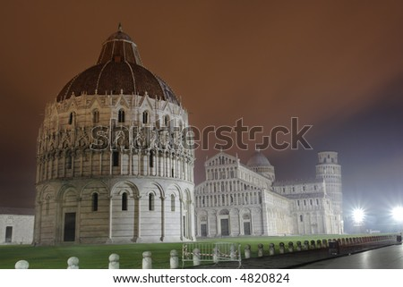 A view of Piazza dei Miracoli with the Cathedral , Baptistery and Leaning tower of Pisa, Italy by night