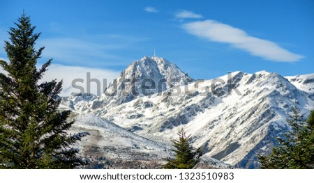 a view of Pic du Midi de Bigorre in the french Pyrenees with snow
