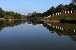 a view of putrajaya lake with government building reflection