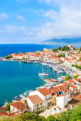 A view of Pythagorion port with colourful houses and blue sea, Samos island, Greece
