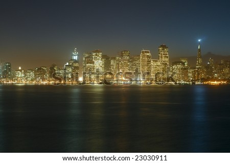 A view of San Francisco downtown at dusk (shot from Treasure Island). This illumination is on only for Christmas and New Year (~1.5 months per year). Copyspace on top and bottom