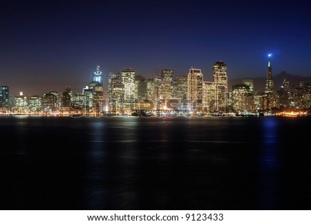 A view of San Francisco downtown decorated by Christmas lighting at dusk (shot from Treasure Island). Copyspace on top and bottom