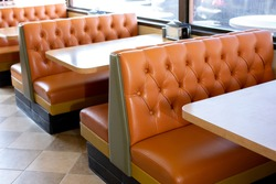 A view of several vintage restaurant banquette style bench seating in a local burger restaurant in Los Angeles, California.