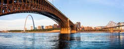 A view of St Louis and The Gateway Arch seen through Eads Bridge