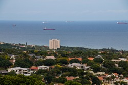 A view of suburbia with sea and ships in distance in Umhlanga, Kwazulu-Natal