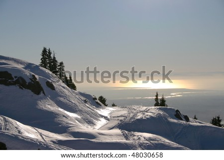 A view of sunset Vancouver in the snow peak.