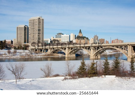 A view of the Broadway Bridge and downtown Saskatoon, Canada on a sunny day in winter.