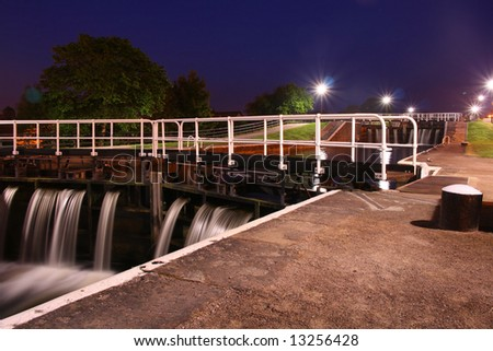 A view of the canal locks at night - long exposure - stock photo
