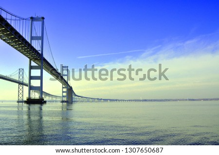 A View of the Chesapeake Bay Bridge that connects Annapolis, Maryland with the Eastern Shore. There is Blue Sky and Room for Text.  #1307650687